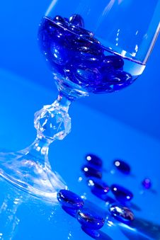 Free Wine Glass With Water And Pills Royalty Free Stock Photography - 5696657