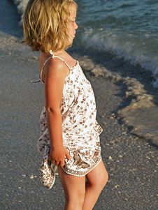 Free Little Girl By The Ocean Stock Photography - 5696992