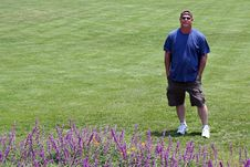 Free Man Green Lawn, Purple Flowers Stock Photography - 5697422