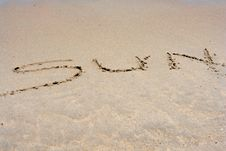 The Word SUN Written In Sand Royalty Free Stock Photos