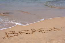 Free The Word BEACH Written In Sand Stock Photography - 5697772