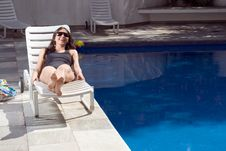 Free Woman Smiling By Pool - Horizontal Stock Images - 5698104