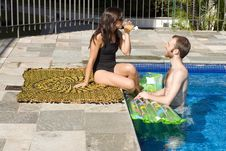 Couple In And Beside Pool - Horizontal Royalty Free Stock Images