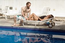 Free Couple On Pool Chair - Horizontal Stock Photo - 5698660