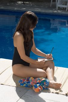 Free Woman Writing Next To A Pool - Vertical Stock Photo - 5698850