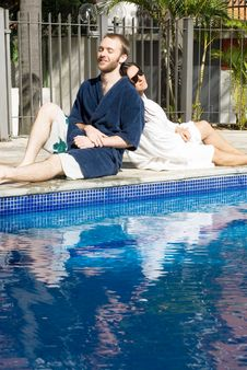 Free Man And Woman Lounging Beside A Pool - Vertical Stock Photos - 5698993