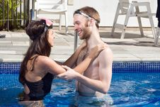 Man And Woman Looking At Each Other In A Pool Stock Image