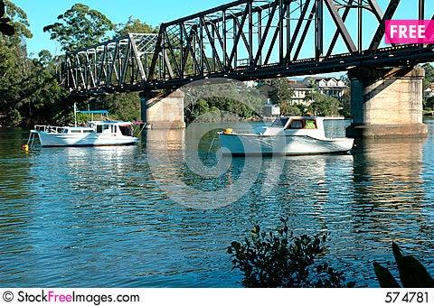 Free Boats Moored Under The Bridge Stock Image - 574781