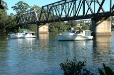 Free Boats Moored Under The Bridge Stock Image - 574781