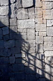 Free Deep Shadows On A Tiled Stone Wall Royalty Free Stock Images - 576549