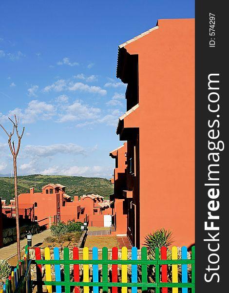 Salmon or orange apartments on Spanish urbanisation