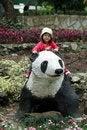 Free Child Sitting On Panda Statue Royalty Free Stock Photo - 5701125