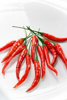 Free Red Hot Peppers On White Plate Stock Photography - 5700692