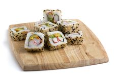 Bread-board With Sushi Slices Royalty Free Stock Image