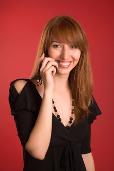 Free Smiling Girl In Evening Dress With Mobile Phone Royalty Free Stock Photos - 5703238