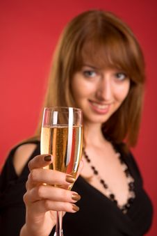 Free Cheers! Girl With Champagne, Focus On Glass Stock Photo - 5703310