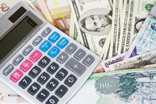 Free Different Currencies And Calculator Stock Photo - 5703550