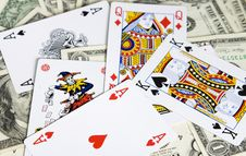 Poker Cards And Dollar Bills Royalty Free Stock Image