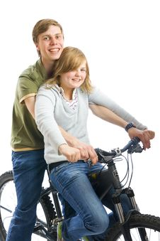 Free Young Couple On A Bicycle Isolated On A White Stock Images - 5705954