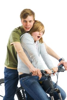 Free Young Couple On A Bicycle Isolated On A White Stock Images - 5705974