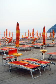Free Closed Umbrellas On The Beach Royalty Free Stock Image - 5706006