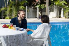 Free Couple Talking By Pool - Horizontal Stock Image - 5706671
