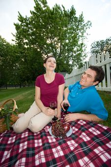 Free Couple Laughing At Picnic - Vertical Royalty Free Stock Images - 5706709
