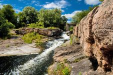 Free River Stream With Rocks And Bridge Royalty Free Stock Photos - 5707278