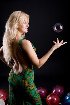 Girl With Ballons And Bubbles Stock Images
