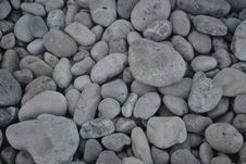 Free Volcanic Pebbles On Beach Royalty Free Stock Image - 57008476