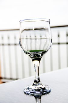 Free Empty Wine Glass On Table Royalty Free Stock Images - 57035339
