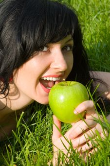 Free Pretty Woman Eating Green Apple Royalty Free Stock Image - 5710216