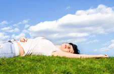 Free Woman Rest On The Green Grass Royalty Free Stock Image - 5710666