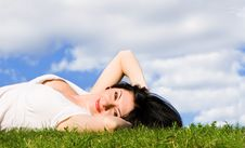 Pretty Woman Rest On The Grass Stock Image