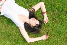 Pretty Woman Rest On The Grass Royalty Free Stock Photo