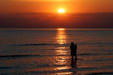 Wading Into The Sunset Stock Photo
