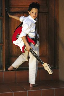 Free Boy With Guitar Stock Photography - 5712512