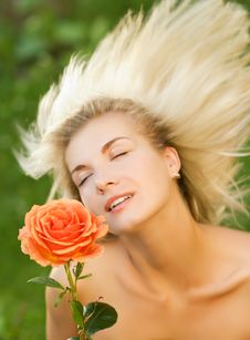 Free Woman With A Rose Royalty Free Stock Photo - 5713465