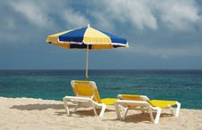 Two Chairs And Beach Umbrella Stock Images