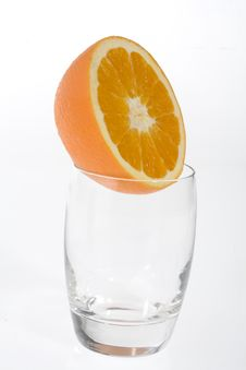 Free Half Orange In A Glass Royalty Free Stock Photography - 5714187