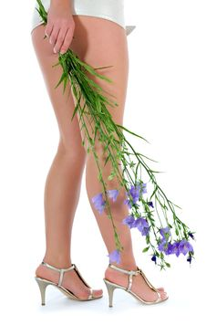 Long Legs On High Heels With Flowers Stock Images
