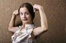 Free Young Woman Flexing Her Biceps Stock Image - 5717831