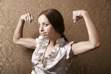 Free Young Woman Flexing Her Biceps Royalty Free Stock Photo - 5717855