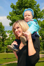 Free Mother With Child On Shoulders Outdoor Stock Photos - 5722593