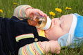 Free Child Drinks From A Bottle Laying In  Grass Royalty Free Stock Photos - 5722738