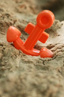 Toy Anchor In Sand Stock Photo
