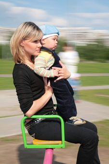 Free Mother And Son On Carousel Royalty Free Stock Photography - 5722847