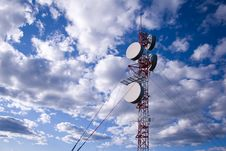 Microwave Tower In Clouds Stock Photo