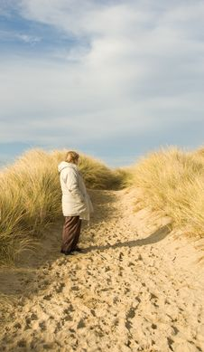 Woman In The Dunes Stock Photo