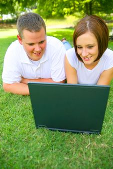 Free Couple Looking At Laptop With Smile Royalty Free Stock Images - 5724019